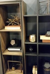 Gold and black bookshelves